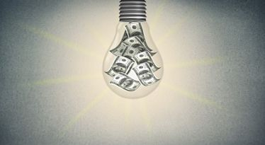 Light Bulb Burning Money